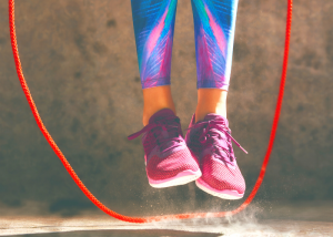 picture of someone's feet jumping in the air with a jumprope