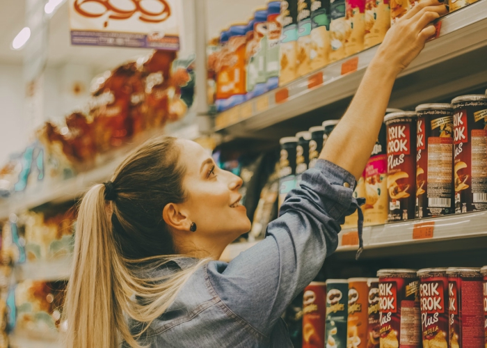 woman looking at products on the grocery aisle