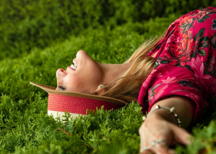 woman laying in the grass smiling